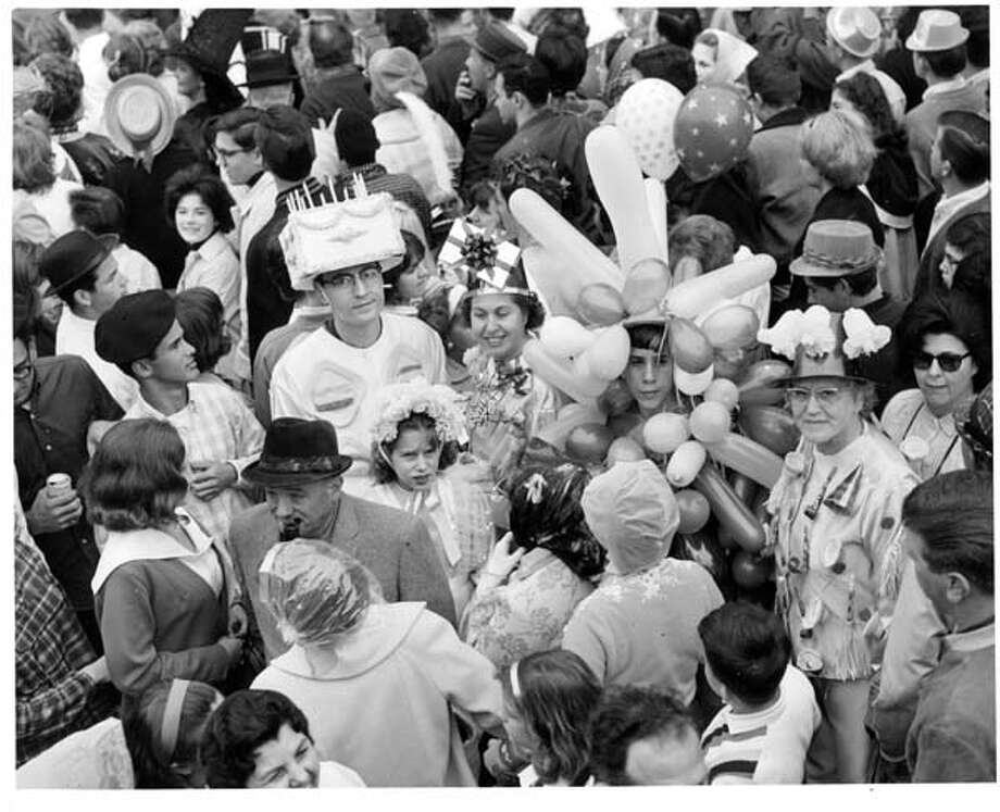 A view of Mardi Gras parade goers in New Orleans, Louisiana circa 1950. Photo: Pictorial Parade, Getty Images / 2013 Getty Images