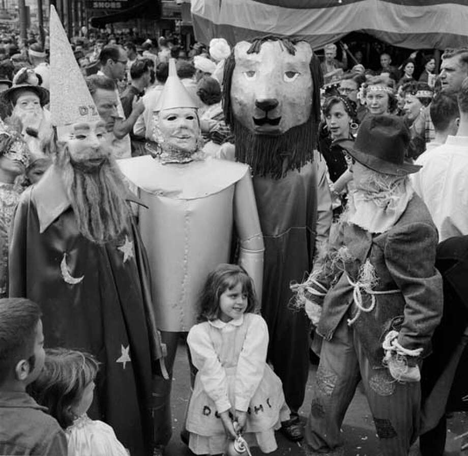 A group arrives at the New Orleans Mardi Gras dressed as characters from 'The Wizard of Oz' - the Wizard, the Tin Man, the Cowardly Lion, the Scarecrow and a young Dorothy. The festivities continue throughout the week before Lent. Photo: Three Lions, Getty Images / Hulton Archive