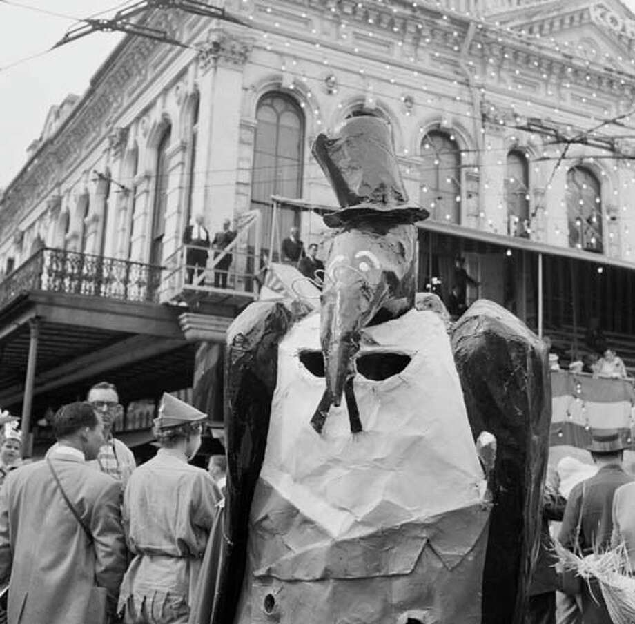 A man dressed as a pelican in a top hat and spectacles at the New Orleans Mardi Gras parade circa 1955. Photo: Three Lions, Getty Images / Hulton Archive