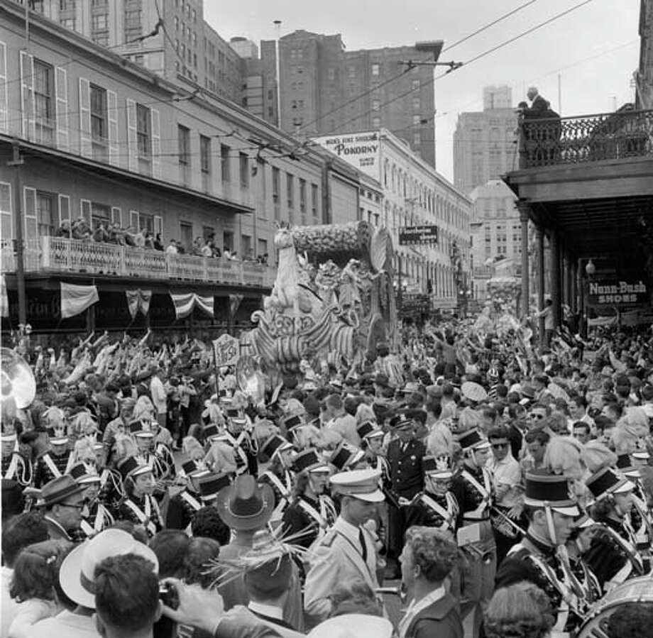 A float at the New Orleans Mardi Gras represents the biblical theme of Moses parting the Red Sea, while a marching band leads the procession circa 1955. Photo: Three Lions, Getty Images / Hulton Archive