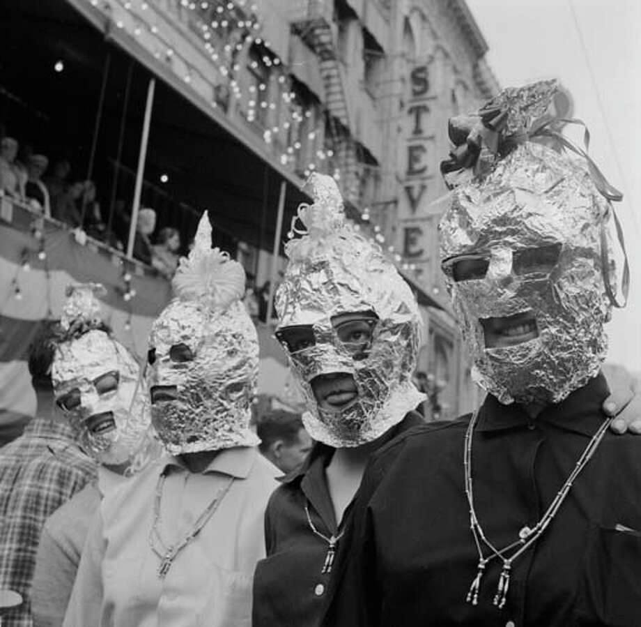 Among the less spectacular of the costumes at the New Orleans Mardi Gras are these home-made tin foil balaclavas in circa 1955. Photo: Three Lions, Getty Images / Hulton Archive