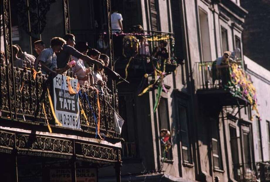 Iron work balconies in New Orleans filled with onlookers watching the Mardi Gras parade in New Orleans, Louisiana in February 1961. Photo: Ernst Haas, Getty Images / Ernst Haas