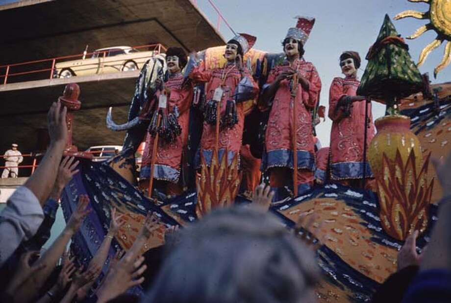 Figures on a float being greeted by the crowd in a Mardi Gras procession in New Orleans, Louisiana in February 1961. Photo: Ernst Haas, Getty Images / Ernst Haas