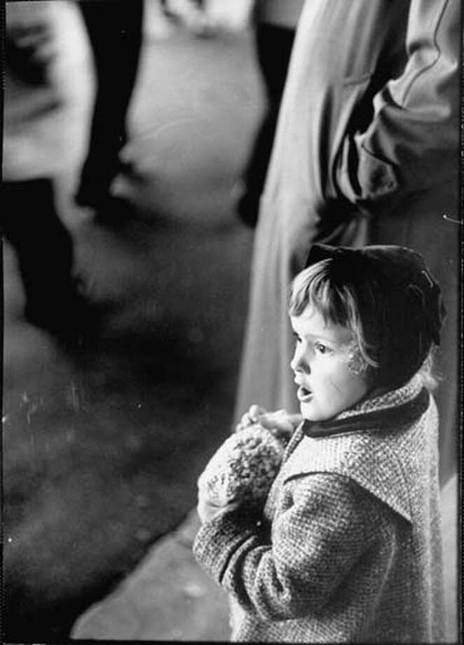 Small girl watching the Mardi Gras Parade in New Orleans, Louisiana in February 1961. Photo: Robert W. Kelley, Time & Life Pictures/Getty Image / Time Life Pictures