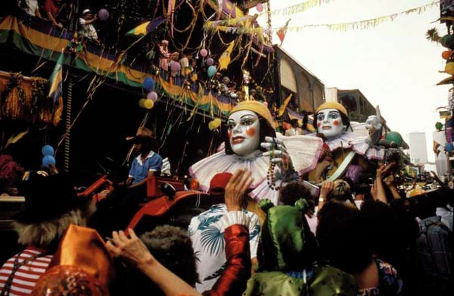 Revelers celebrate Mardi Gras in New Orleans, Louisiana circa 1970. Photo: David Redfern, Redferns / Redferns