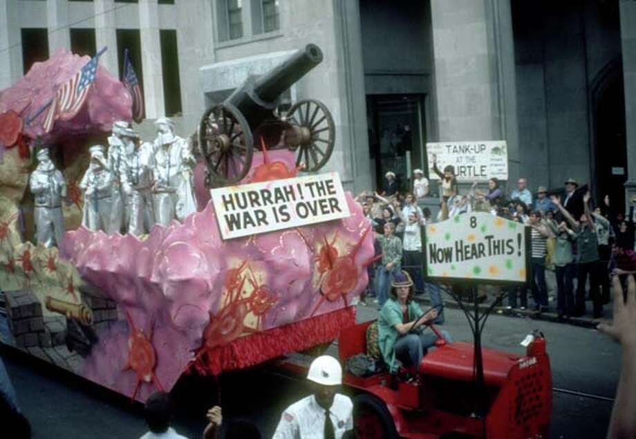 View of a float that carries a cannon and a sign which reads 'Hurrah! The War is Over' in the Mardi Gras parade in New Orleans, Louisiana in February 1973. Photo: Tim Boxer, Getty Images / Archive Photos