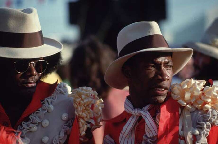 Felt fedoras, red shirts and rosettes are part of their costume for these Mardi Gras participants in New Orleans, Louisiana in 1979. Photo: Ernst Haas, Getty Images / Ernst Haas