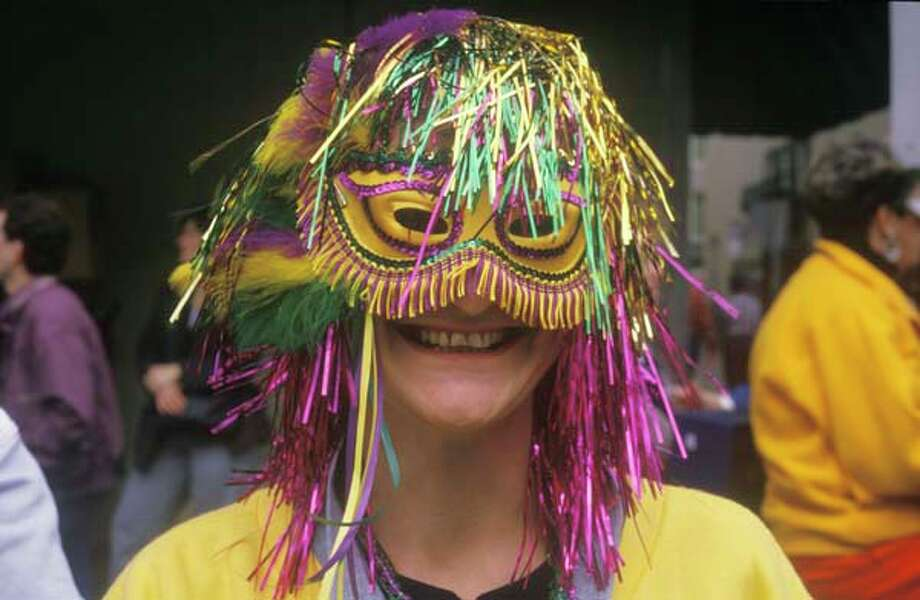 A woman wearing a Mardi Gras Mask in New Orleans, Louisiana in January 1988. Photo: Visions Of America, UIG Via Getty Images / © 2004 VisionsofAmerica.com/Joe Sohm.  All Rights Reserved. (800) SOHM-USA (764-6872)