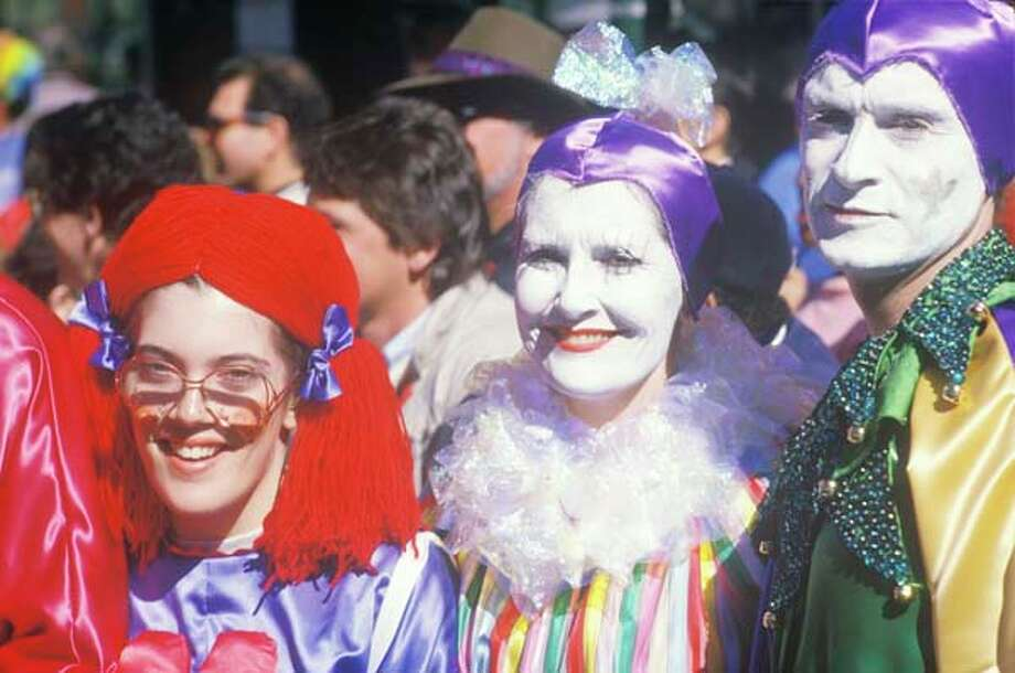 People dressed up in Mardi Gras costumes in New Orleans, Louisiana in January 1988. Photo: Visions Of America, UIG Via Getty Images / © 2004 VisionsofAmerica.com/Joe Sohm.  All Rights Reserved. (800) SOHM-USA (764-6872)