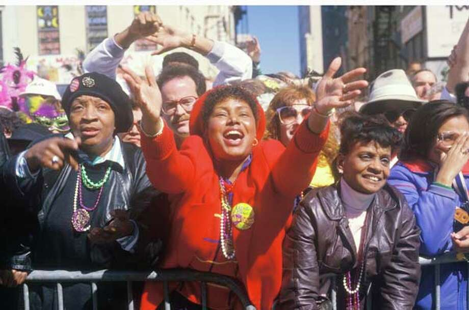 Joyous Spectators at the Mardi Gras Parade in New Orleans, Louisiana in January 1988. Photo: Visions Of America, UIG Via Getty Images / © 2004 VisionsofAmerica.com/Joe Sohm.  All Rights Reserved. (800) SOHM-USA (764-6872)