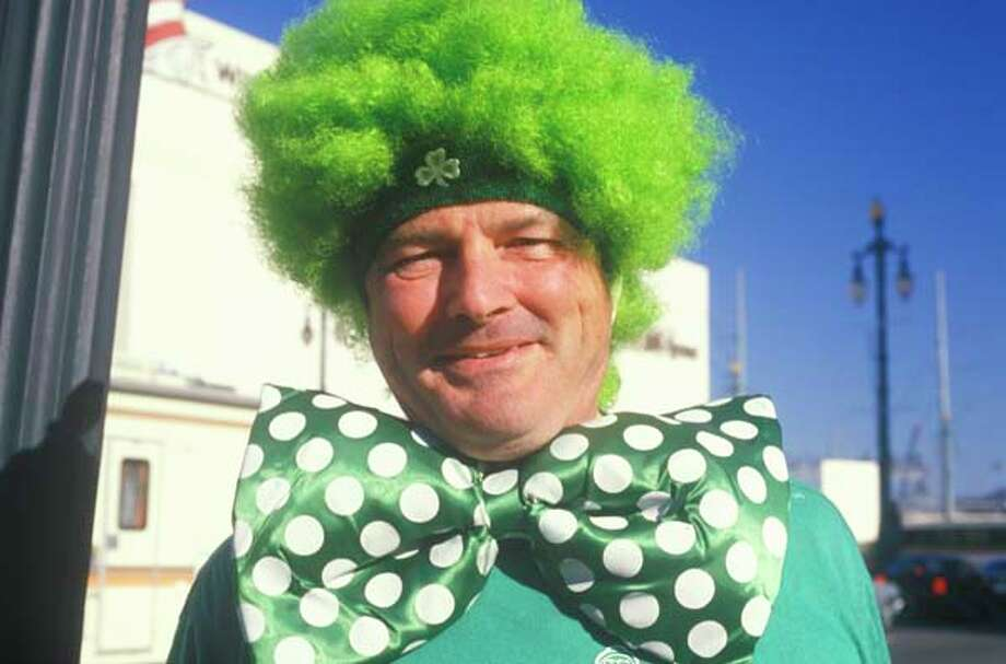 Man wears a green Mardi Gras costume in New Orleans, Louisiana in January 1988. Photo: Visions Of America, UIG Via Getty Images / © 2004 VisionsofAmerica.com/Joe Sohm.  All Rights Reserved. (800) SOHM-USA (764-6872)