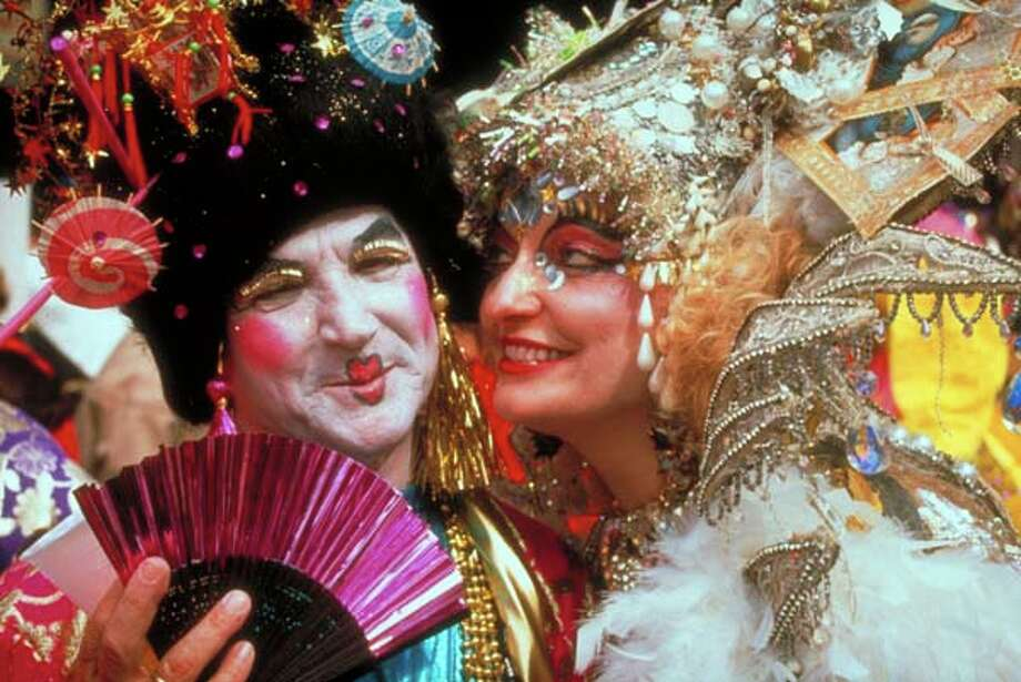 An elaborately costumed and made-up couple celebrate Mardi Gras in New Orleans, Louisiana in February 1991. Photo: Mitchel Osborne, Time & Life Pictures/Getty Image / Mitchel Osborne