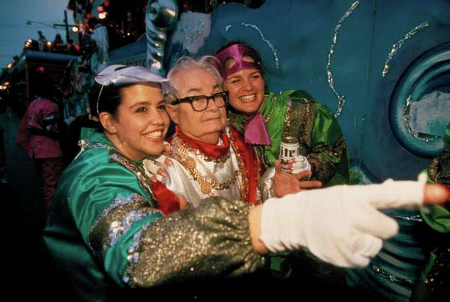 Actor Calvert DeForest (aka Larry Bud Melman) and a couple of women wear royal outfits atop Krewe of Orpheus float during Mardi Gras in 1995. Photo: Bruce Kluckhohn, Time & Life Pictures/Getty Image / Bruce Kluckhohn