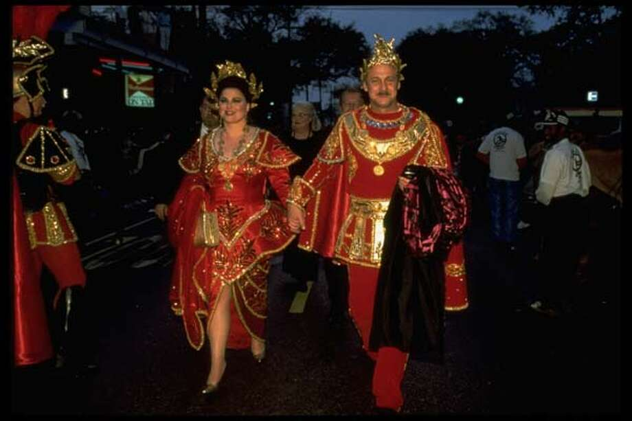 Married actors Delta Burke & Gerald McRaney wear royal outfits while walking hand-in-hand outside on their way to the Mardi Gras ball in New Orleans, Louisiana in 1995. Photo: Bruce Kluckhohn, Time & Life Pictures/Getty Image / Bruce Kluckhohn