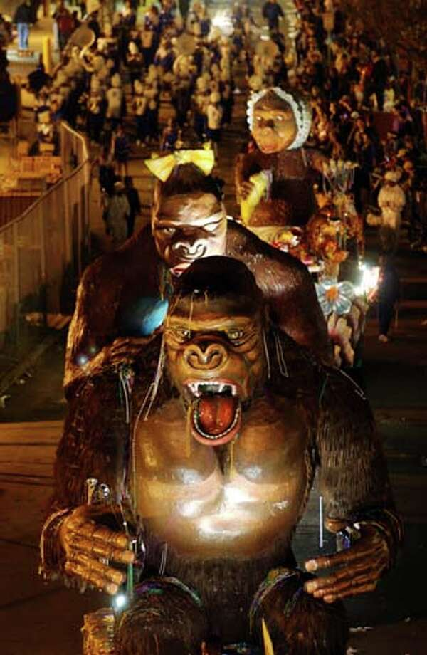 The floats of King Kong, Queen Kong and Baby Kong move along the Bacchus parade as Mardi Gras goers countdown to Fat Tuesday on March 2, 2003 in New Orleans, Louisiana. Photo: David McNew, Getty Images / 2003 Getty Images