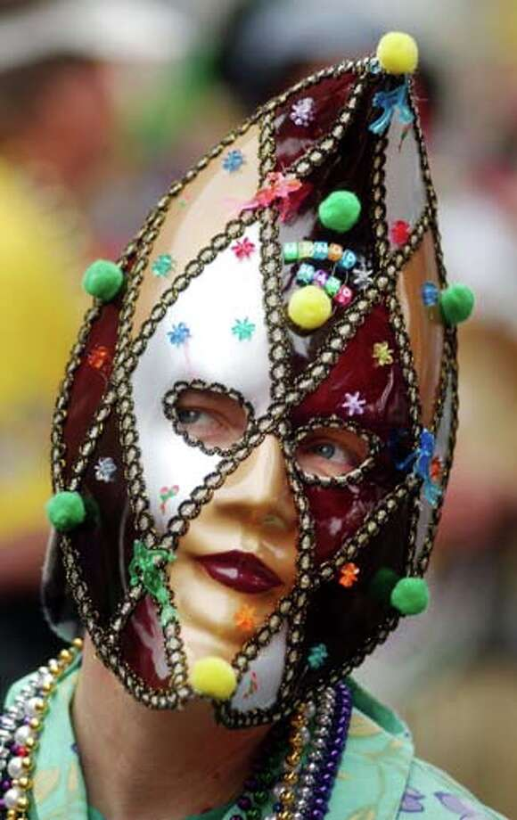 A woman who is a member of the Half Fast Walkers wears a mask on Fat Tuesday during Mardi Gras celebrations on March 4, 2003 in New Orleans, Louisiana. Photo: David McNew, Getty Images / 2003 Getty Images