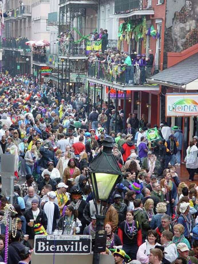 Scenes from the French Quarter's Bourbon street on Mardi Gras Day in New Orleans on February 24, 2004. Photo: James Crump, WireImage / WireImage