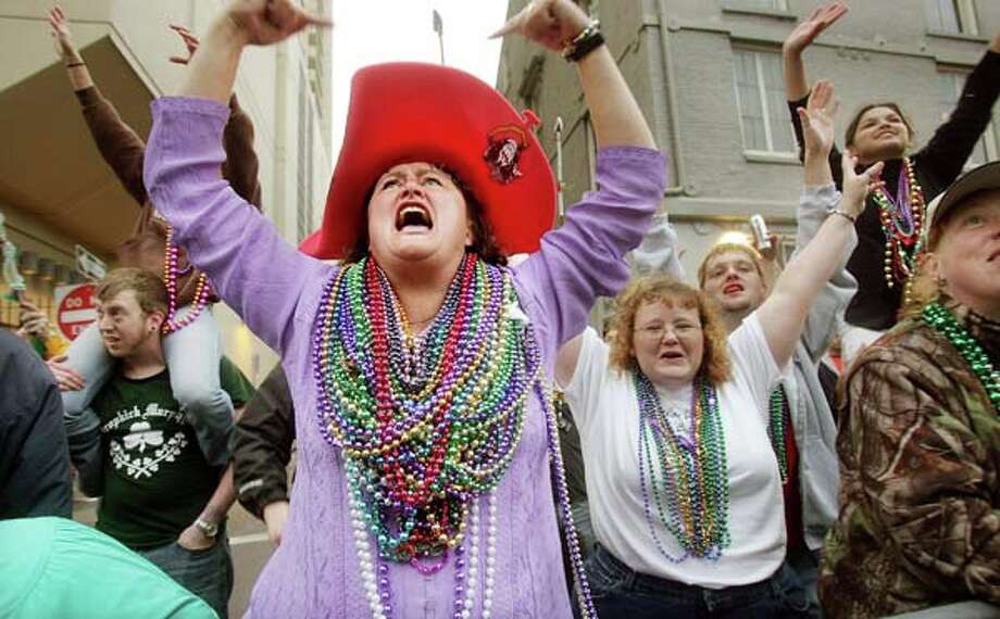 Revelers scream for beads at a parade during Mardi Gras festivities on February 6, 2005 in New Orleans, Louisiana. Photo: Mario Tama, Getty Images / 2005 Getty Images