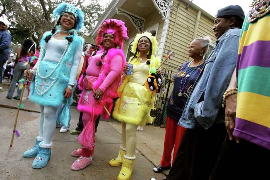 Women dress as Native Americans during the Zulu parade, a primarily African-American parade, during Mardi Gras festivities February 8, 2005 in New Orleans, Louisiana. Photo: Mario Tama, Getty Images / 2005 Getty Images