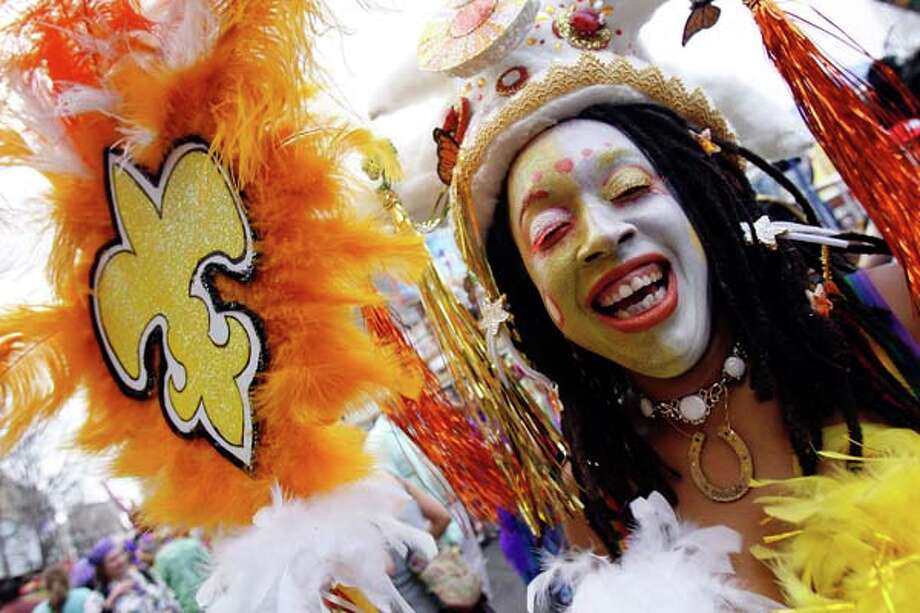 A reveler in the Mondo Kayo parade dances through the streets on Mardi Gras Day on February 20, 2007 in New Orleans, Louisiana. Photo: Chris Graythen, Getty Images / 2007 Getty Images