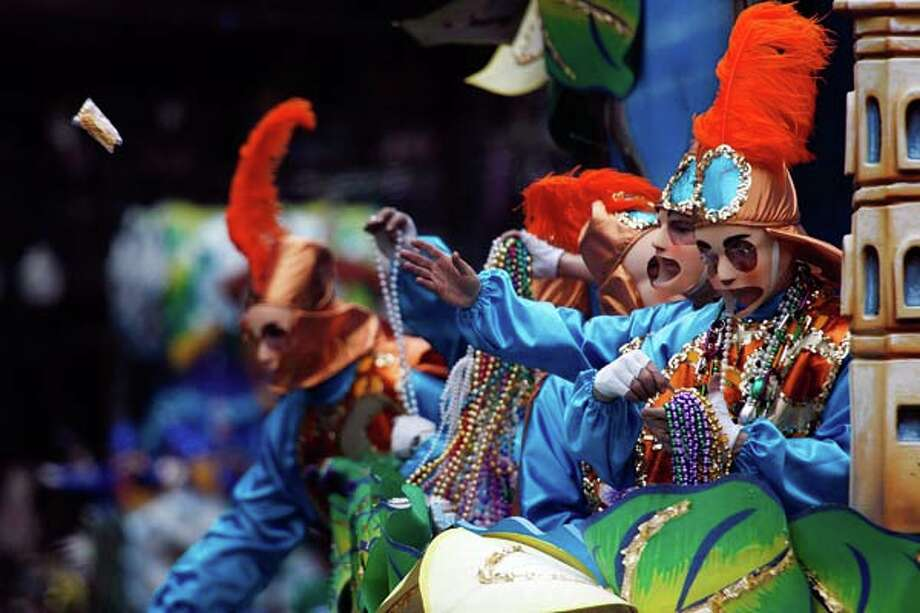 A rider tosses a cup from a float in the Rex parade on Mardi Gras Day February 20, 2007 in New Orleans, Louisiana. Photo: Chris Graythen, Getty Images / 2007 Getty Images