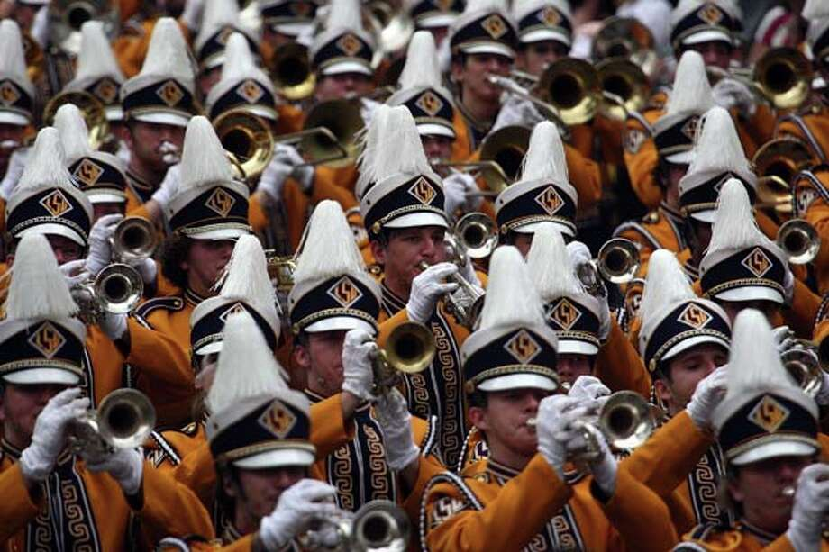 Members of the Louisiana State University Marching band perform in the Rex Parade on St. Charles Avenue on Mardi Gras Day on February 5, 2008 in New Orleans, Louisiana. Photo: Chris Graythen, Getty Images / 2008 Getty Images