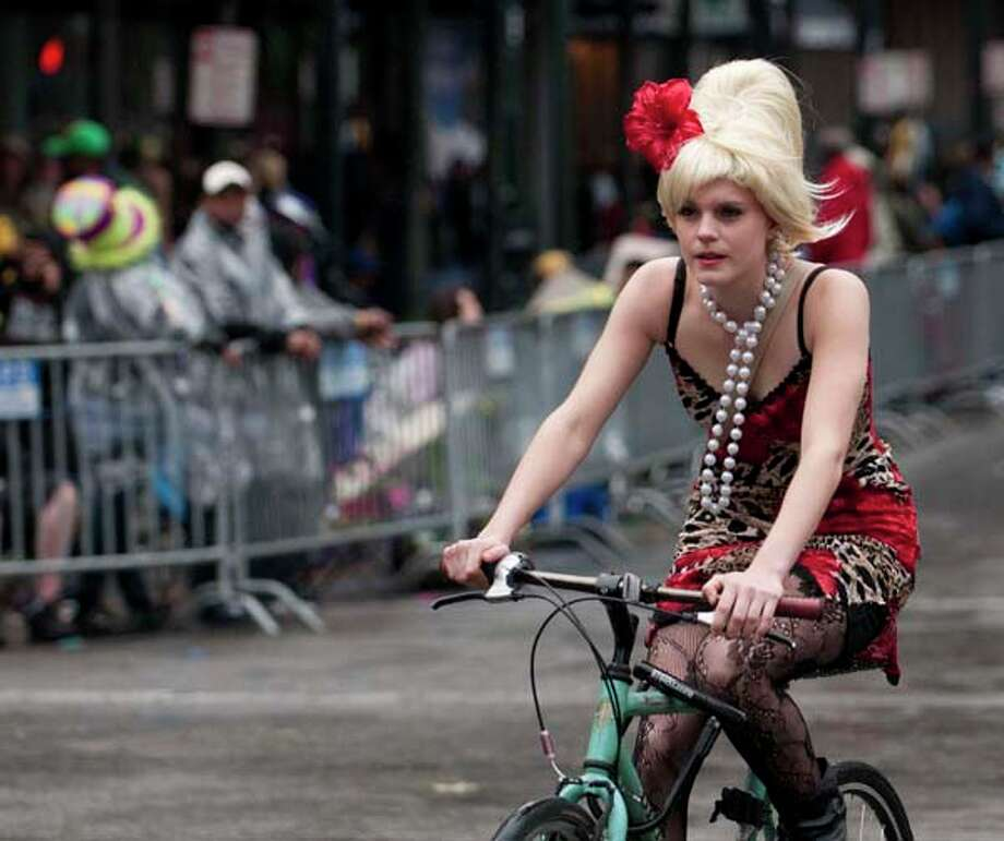 A reveler cruises along Canal Street during the Mardi Gras parade on Fat Tuesday in New Orleans, Louisiana on March 8, 2011. Photo: AFP, AFP/Getty Images / 2011 AFP