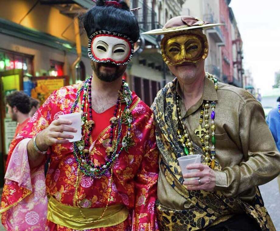 Two men dressed in costume in the French Quarter during the 2011 Mardi Gras Fat Tuesday Celebrations on March 8, 2011 in New Orleans, Louisiana. Photo: Skip Bolen/WireImage, WireImage / 2011 Skip Bolen