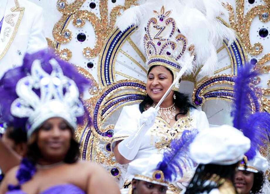 Chanel Howard Barker, Queen Zulu 2011 arrives with the Krewe of Zulu as they march in the Mardi Gras parade on Fat Tuesday in New Orleans, Louisiana on March 8, 2011. Photo: AFP, AFP/Getty Images / 2011 AFP