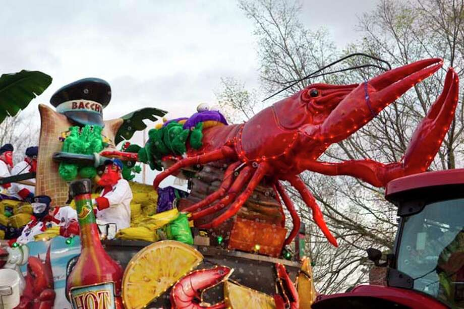 A Krewe of Bacchus Mardi Gras float in the 2012 Krewe of Bacchus Parade on February 19, 2012 in New Orleans, Louisiana. Photo: Skip Bolen, Getty Images / 2012 Getty Images