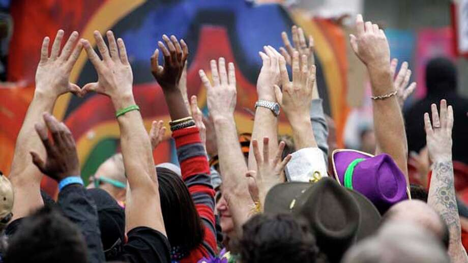 Revelers plead for throws from riders in the Krewe of Zulu parade on Mardi Gras Day on February 12, 2013. Photo: Rusty Costanza, Getty Images / 2013 Getty Images