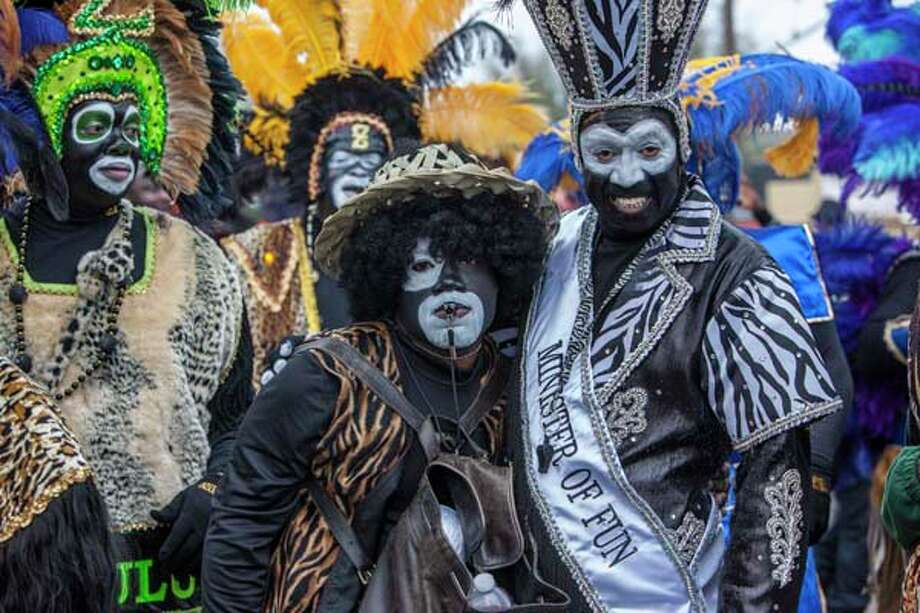 Members of the Zulu Social Aid & Pleasure Club pose while marching in the Zulu Parade on Jackson Avenue, the first parade on the morning of Mardi Gras Day on February 12, 2013 in New Orleans, Louisiana. Photo: Skip Bolen, Getty Images / 2013 Skip Bolen