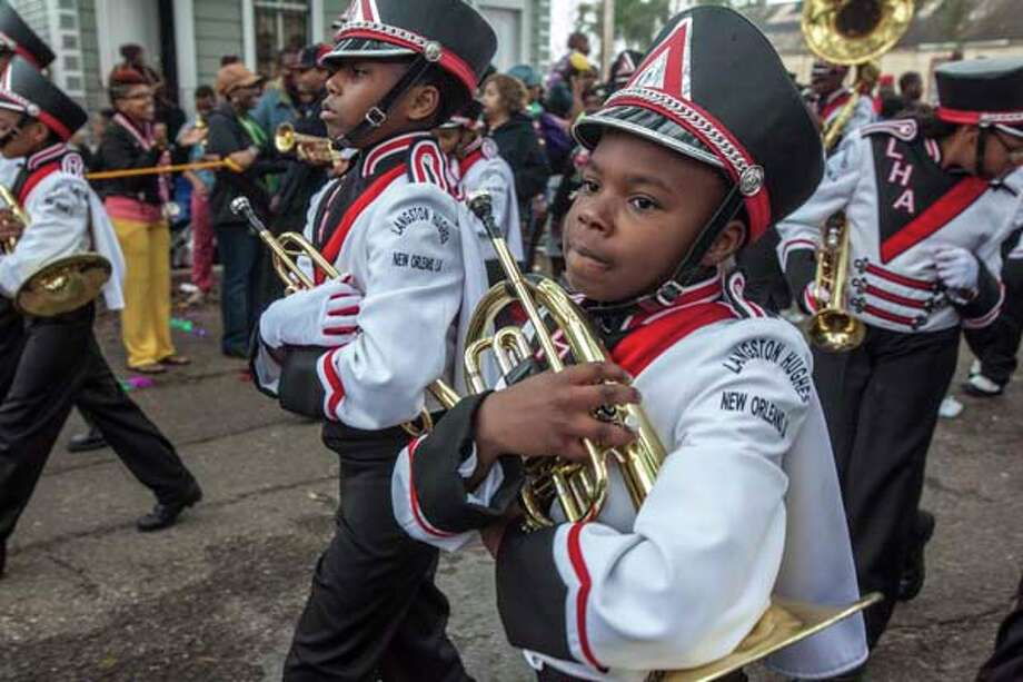 A young musician in the Langston Hughes Academy School marching band in the 'Zulu Parade' on Jackson Avenue, the first parade on the morning of Mardi Gras on February 12, 2013 in New Orleans, Louisiana. Photo: Skip Bolen, Getty Images / 2013 Skip Bolen