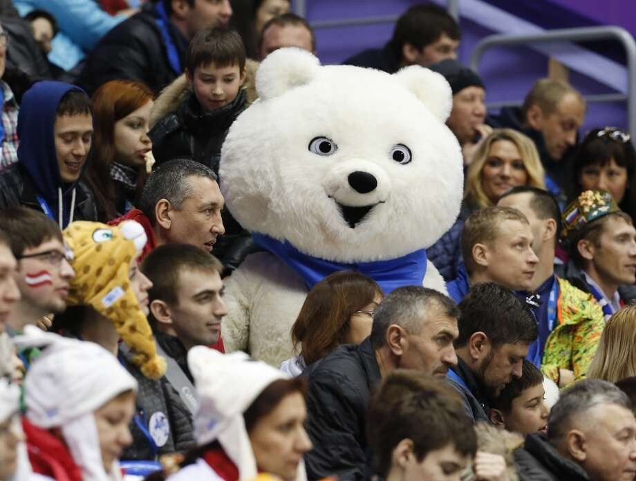 One of the Olympic mascots watches play with fans between Austria and Norway in the third period of a men's ice hockey game at the 2014 Winter Olympics, Sunday, Feb. 16, 2014, in Sochi, Russia. Photo: Mark Humphrey, Associated Press
