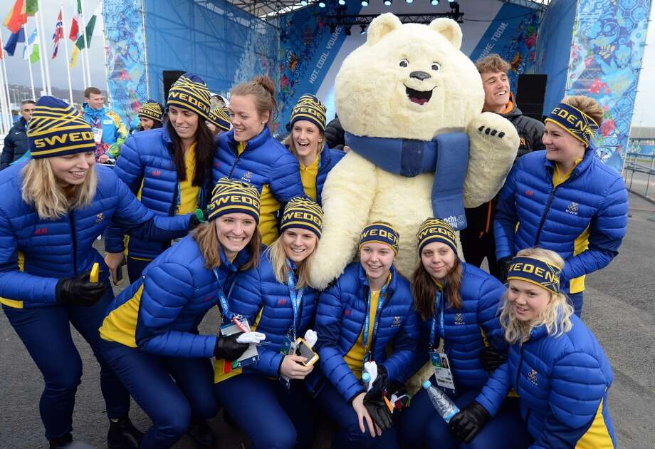 Members of the Swedish delegation pose next to a mascot during the welcoming ceremonies ahead of the Sochi Winter Olympics, on February 5, 2014 at the Amphitheatre Square in Sochi. Photo: ANDREJ ISAKOVIC, AFP/Getty Images
