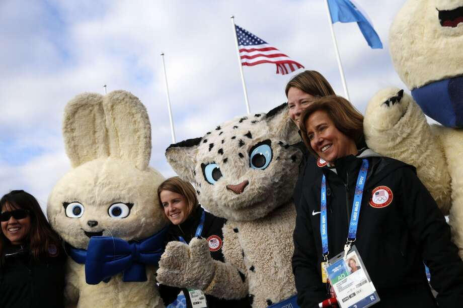 US team officials poses and mascots Polar Bear, Leopard and Hare during the team welcome ceremony on February 6, 2014 prior to the start of the 2014 Sochi Winter Olympic Games. Photo: ADRIAN DENNIS, AFP/Getty Images
