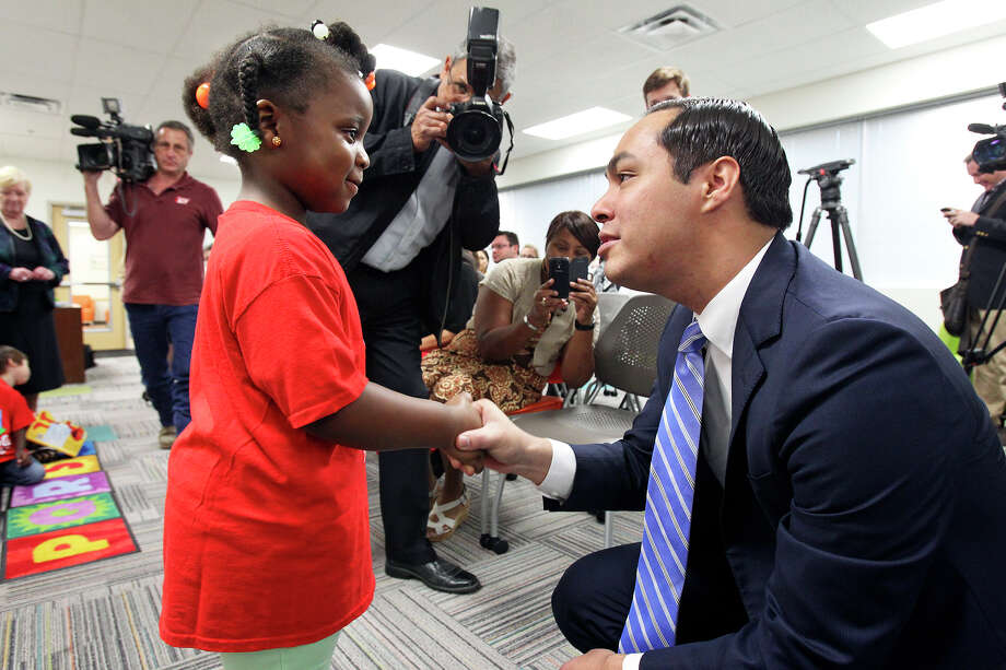 Mye'Uniq Washington steps up to shake the mayor's hand as  Julian Castro helps to unveil the  plans for additional educations centers during ceremonies at the Southside Pre-K4 SA center on February 19, 2014. Photo: TOM REEL