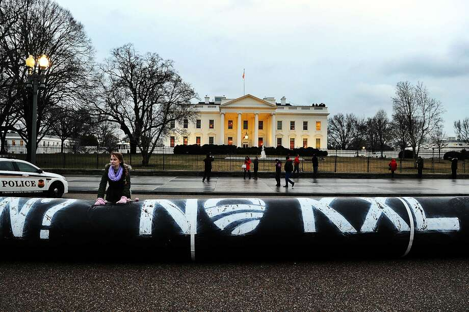 Environmental activists inflate a long balloon to mock a pipeline during a demonstration in front of the White House in Washington, DC, on February 3, 2014 to  protest against the Keystone pipeline project. The US State Department last week released a long-awaited review of a controversial pipeline project to bring oil from Canada to Texas, suggesting it would have little impact on climate change or the environment. The project has pitched environmental groups against the oil industry, which has argued that it will bring much-needed jobs to the United States and help fulfill the US goal of energy self-sufficiency. AFP PHOTO/Jewel SamadJEWEL SAMAD/AFP/Getty Images Photo: Jewel Samad, AFP/Getty Images