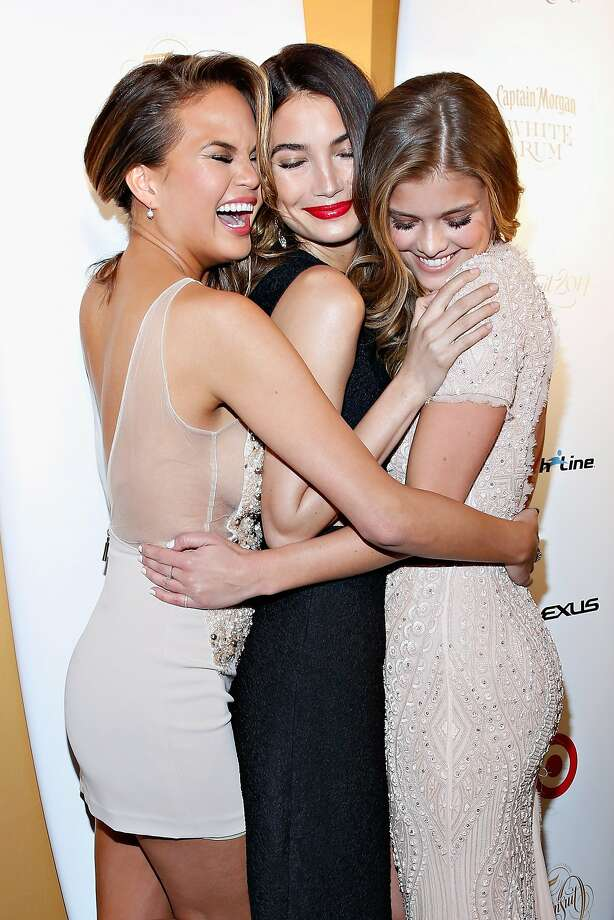 We S.I. models have to stick together: Chrissy Tiegen, Lily Aldridge and Nina Agdal feel a hug coming on as Captain Morgan White Rum and Crown Royal XO raise a glass at the 50 Years of Sports Illustrated Swim Issue celebration in New York City. Photo: Cindy Ord, Getty Images For Captain Morgan