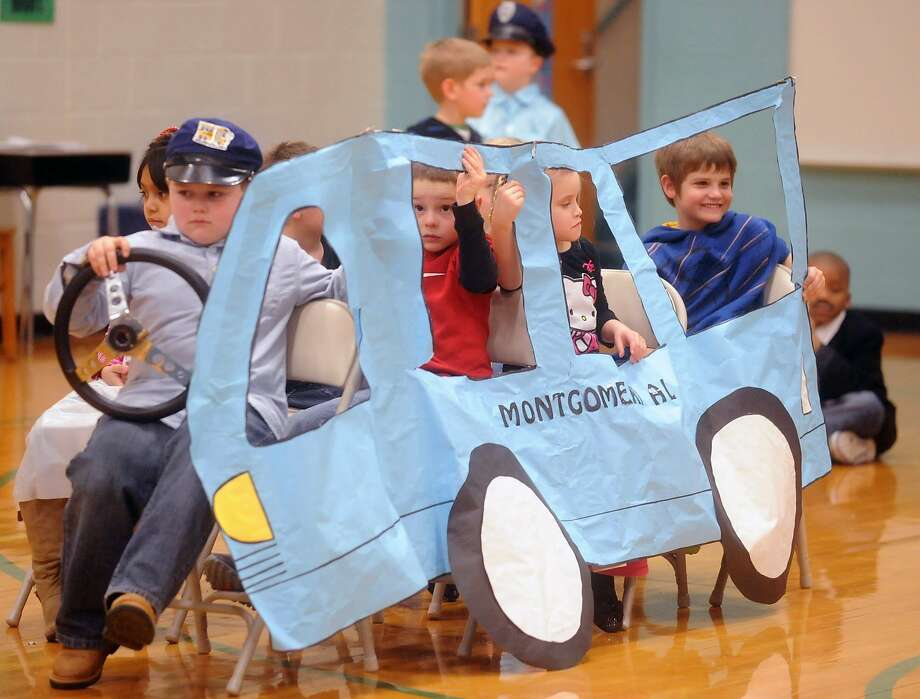 "The wheels on the Rosa Parks bus go round and round:In Owensboro, Ky., Deer Park Elementary first-graders perform the play ""The Story of a Dream."" Photo: John Dunham, Associated Press"