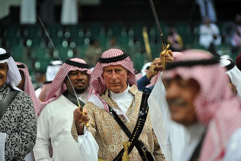 Charles of Arabia: Wielding a sword, a keffiyeh-topped Prince of Wales performs the traditional Saudi dance known as the Arda at the Janadriya culture festival in Riyadh, Saudi Arabia. Photo: Fayez Nureldine, AFP/Getty Images