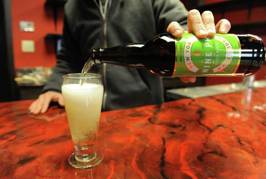 A fresh poured glass of Nine Pin Cider on Friday Feb. 14, 2014 in Albany, N.Y. (Michael P. Farrell/Times Union) Photo: Michael P. Farrell / 00025759A