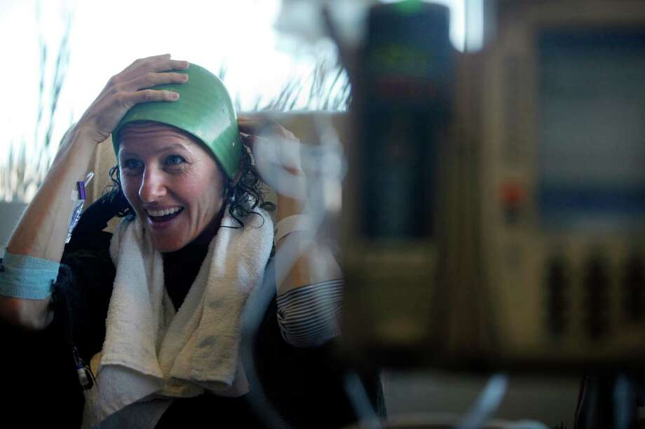 Breast cancer patient Deborah Cohan makes final adjustments to her DigniCap - a silicon cooling cap - prior to the start of her chemotherapy treatment. Photo: Lea Suzuki, Staff / ONLINE_YES