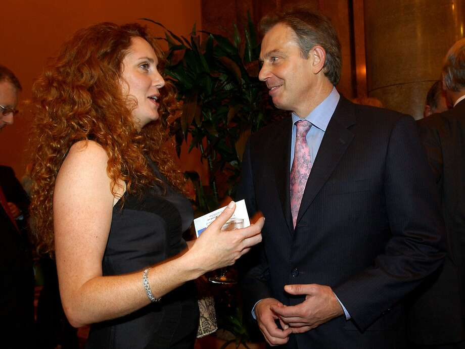 FILE - This Oct. 26, 2004 file photo shows former British Prime Minister Tony Blair with former News International Chief Executive Rebekah Brooks. Jurors at Britain's phone-hacking trial were told Wednesday, Feb. 19, 2014, that former Prime Minister Tony Blair allegedly offered to work as an unofficial adviser to Rupert Murdoch as revelations of illegal phone hacking engulfed the mogul's media empire. (AP Photo/PA, Fiona Hanson, File) UNITED KINGDOM OUT, NO SALES, NO ARCHIVE Photo: Fiona Hanson, Associated Press