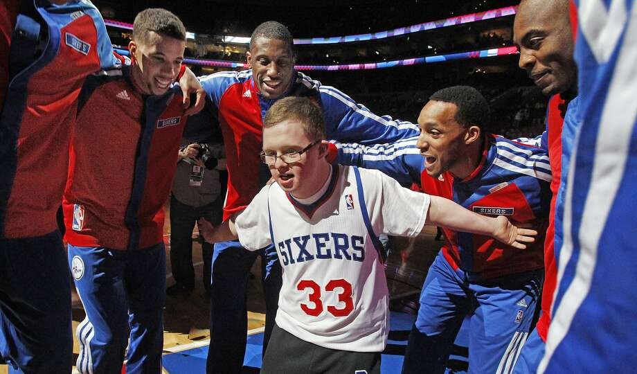 "Sixers sign a sharpshooter:The Philadelphia 76ers have signed Bensalem High senior Kevin Grow to a ""ceremonial two-game"" contract. In his final two high school games, Kevin - who has Down syndrome - scored 14 points, including three 3-pointers and a buzzer beater. Photo: Ron Cortes, McClatchy-Tribune News Service"