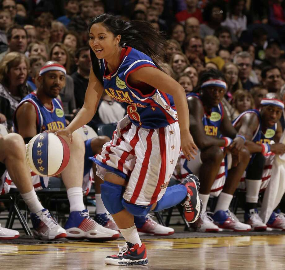 "T-Time Brawner, one of three females on the Harlem Globetrotters roster, will join her team for some quality play and performance when the crew makes a stop in Bridgeport, Conn., at the Webster Bank Arena, Feb. 21, 2014, as part of its 2014 ""Fans Rule"" Globetrotter World Tour. For more information, visit www.websterbankarena.com. Contributed photo/Harlem Globetrotters International, Inc. Photo: Contributed Photo / Stamford Advocate Contributed"