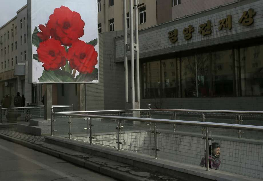 Kim Jong-un's capital: A floral billboard provides the only color on a dreary street in Pyongyang, North Korea. Photo: Vincent Yu, Associated Press