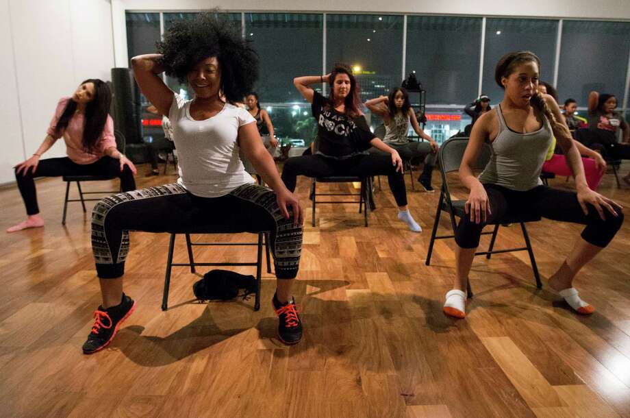 "Cedrina Knight, left, and Yashana Williams participate in a class at Inner Me Studios inspired by Beyonce's steamy ""Rocket"" video. Photo: J. Patric Schneider, Freelance / © 2014 Houston Chronicle"