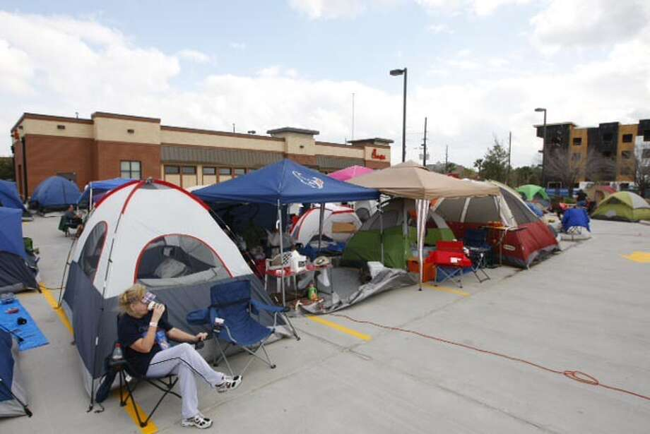 People camp out at the latest Chick-fil-A opening in west Houston, Wednesday, Feb. 19, 2014. The first 100 customers to walk through the doors tomorrow will receive a free Chick-fil-A meal per week for a year. Photo: Cody Duty/Houston Chronicle