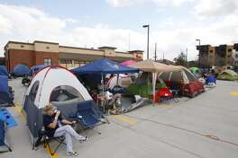People camp out at the latest Chick-fil-A opening in west Houston, Wednesday, Feb. 19, 2014. The first 100 customers to walk through the doors tomorrow will receive a free Chick-fil-A meal per week for a year.